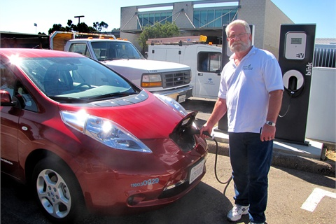 """Jim Ruby of the University of California, San Diego charges one of the school's five Nissan Leafs, acquired as part of the university's """"Tailpipe Endgame"""" sustainability initiative."""