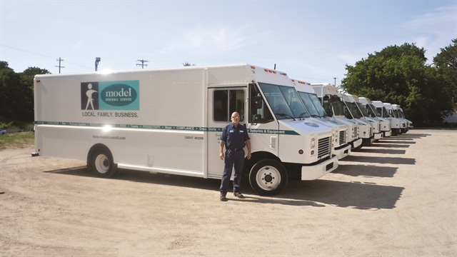 Joe Boyd stands with some of Grand Rapids, Mich.-based Model Coverall Services' delivery step vans. The company just purchased four additional 20-foot vans from Utilimaster with a Freightliner chassis and a Cummins automatic engine, and has made the decision to standardize any new purchases to this selection.