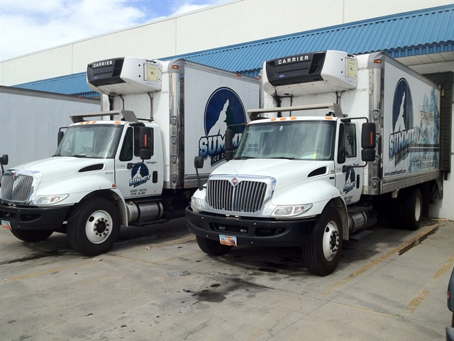 "Summit Ice, a Salt Lake City-based ice distribution company, leases almost all of its 15 vehicles through Penske and Ryder, including these 20-foot straight trucks from International. Summit Ice President Brian Washnock said he doesn't plan to start purchasing his own trucks as he likes the ""peace of mind"" afforded by the truck leasing companies."