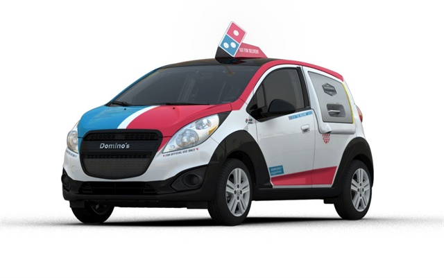 Domino's DXP vehicle is built on the Chevrolet Spark platform and features a warming oven, storage areas for pizza, and a console to hold other smaller menu items. Photo courtesy of Domino's.