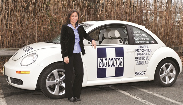 The VW Beetle is one of several different types of vehicles in Bug Doctor's fleet. Each white-colored fleet vehicle includes several company logos.