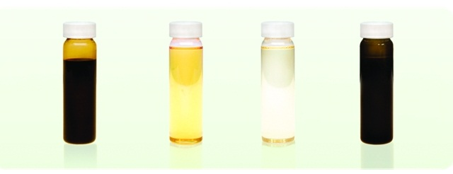 Photo courtesy of Safety-Kleen.From left to right are comparisons of crude oil, conventional base motor oil made from crude, EcoPower base oil made from used motor oil and used motor oil.