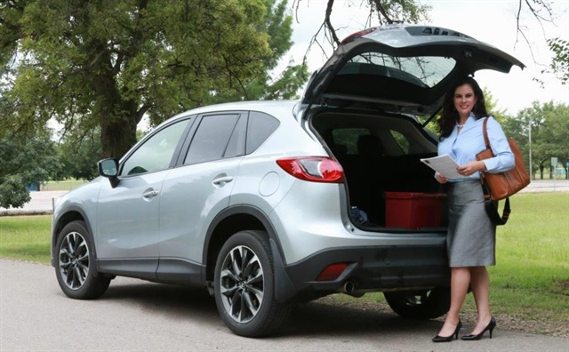 Jennifer Rivera, a salesperson for Organogenesis, drives the Mazda CX-5 as her work vehicle when traveling to clients in Kansas and Nebraska. She says that she usually picks silver or white to help the vehicle look less dirty. Photo courtesy of Eye Kandy Photography.
