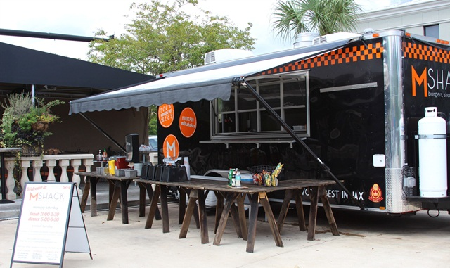 MShack's food trailer provides a mobile kitchen to cater at local events, including Jacksonville Jaguar football games.