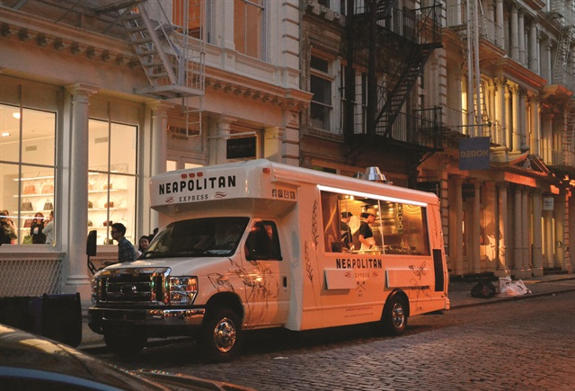 Neapolitan Express' green and high-tech food trucks feature a natural gas engine, a natural-gas tank with a hot water heating system, seven iPads and solar panels.