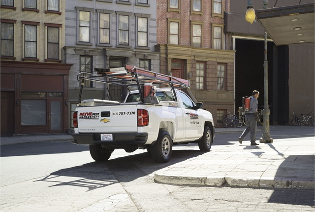 One of the company's Silverado trucks equipped with a ladder rack, a cross box and a side box.