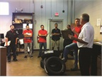 Wheelz Up, a Washington-D.C.-based auto parts delivery service, holds a safety meeting with some of its fleet drivers. Photo courtesy of Wheelz Up.