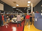 <p><em>Photography by Chris Wolski</em><br />Dealers bid for cars during a closed sale at South Bay Auto Auction in Gardena, Calif.</p>
