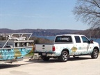 AMS Bowfishing uses diesel F-250 trucks to haul its fishing boats.