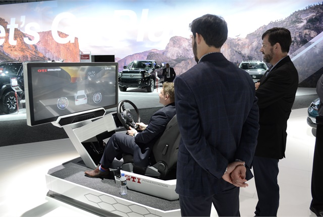 Media-ites drive a Volkswagen GTI - virtually - at the 2017 L.A. Auto Show. (Photo courtesy of Andy Lundin.)