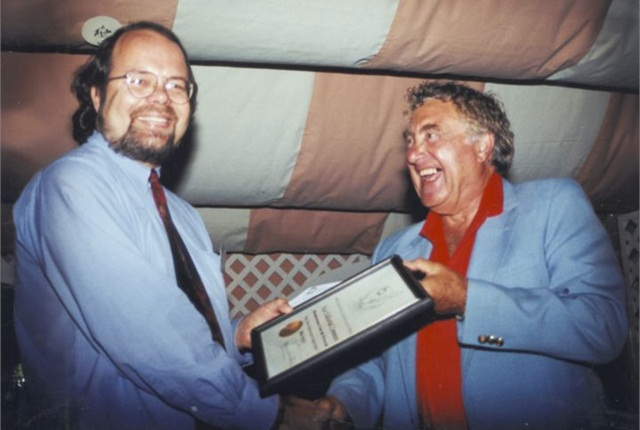 Automotive Fleet Editor Mike Antich accepts an editorial award from Ed Bobit in the late 1980s.