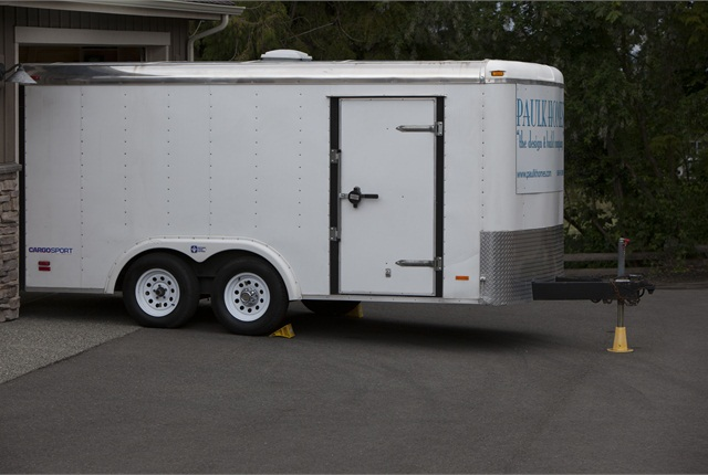 This 16-ft trailer stands at 6 feet, 3 inches and fits in an 8-foot garage door. Subsequent to the photo, Paulk had put a full vinyl wrap on the trailer that advertised his company.