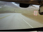 <p>This prototype heads-up display (HUD) highlights road signage (image 1) and road curvature in poor visibility conditions (image 2).</p>