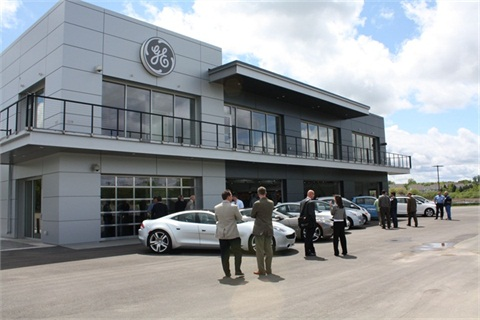 Attendees at the new facility's opening check out the vehicles on display.