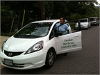 "<p>An Everclean Maid Services supervisor standing with the recently purchased Honda Fit, one of seven vehicles in fleet that the company has put logos on in hopes to ""territorialize"" the company.</p>"