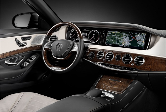 Inside, Mercedes used wood interior trim and created a new console display. Photo courtesy Mercedes-Benz.