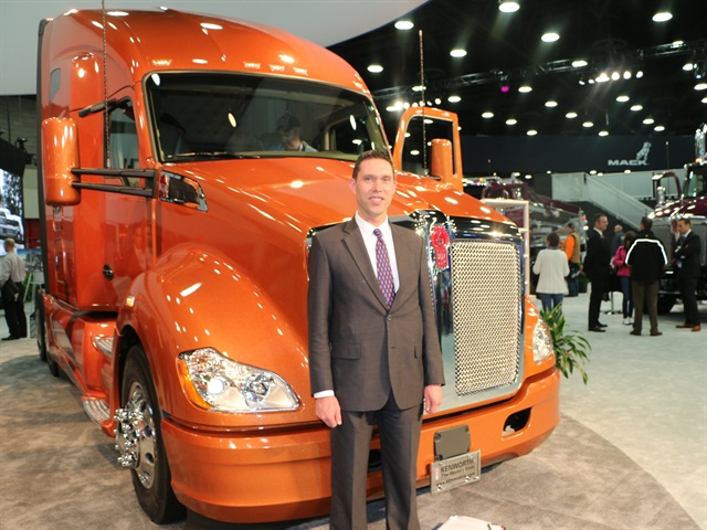 Photo of Kurt Swihart, Kenworth's Director of Marketing with the T680 painted in Imron Elite Aurora color courtesy of Axalta.