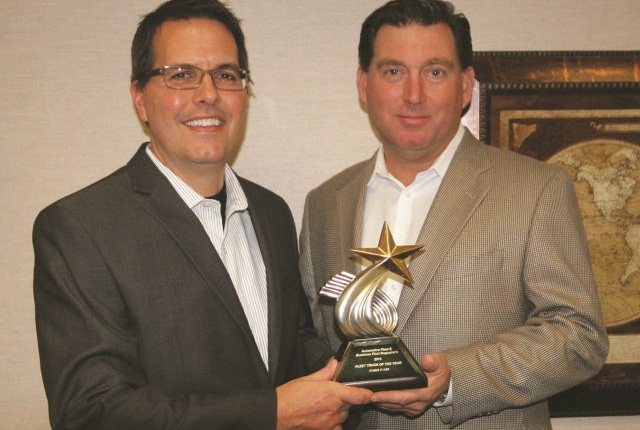 Robert Brown, Great Lakes regional sales manager for Automotive Fleet (right), presents the 2014 Fleet Truck of the Year Award to Fritz Ahadi, general manager of commercial and government operations for Ford Motor Co. Photo courtesy of Robert Brown.