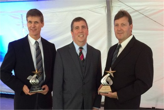Chris Wolski, senior editor of Automotive Fleet and Green Fleet magazines (center), presented The Green Fleet Truck of the Year award to Mark Oldenburg, national fleet marketing, mobility, and strategic planning manager (right) and the Green Fleet Car of the Year award to Jim Michon, commercial business manager for Ford. (PHOTO: Becky May)
