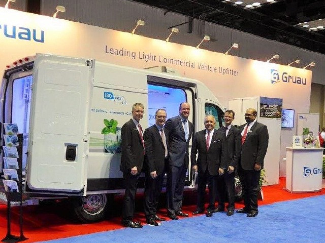 Photo of Knapheide and Gruau executives at the Work Truck Show courtesy of Gruau.