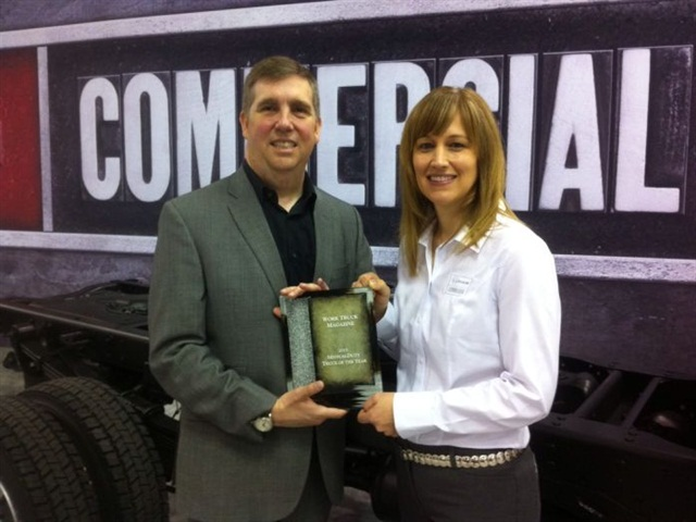 Senior Editor Chris Wolski Presents the Medium-Duty Truck of the Year award to Becky Blanchard, director of the Ram Truck brand. Photo by Chris Brown.