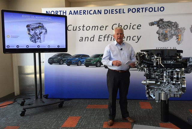 Michael Siegrist, regional chief engineer, shows GM's 1.6L Ecotec turbodiesel engine to journalists. Photo by Chris Brown.