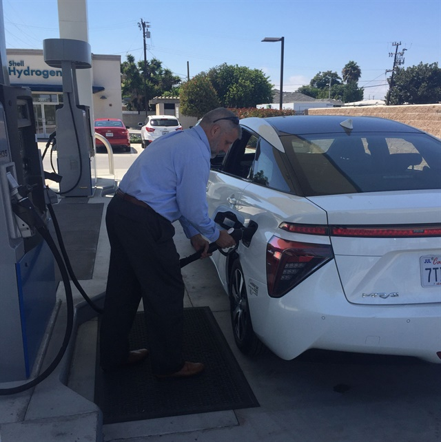 Keith Malone, government relations for the California Fuel Cell Partnership, refuels a Toyota Mirai at Torrance's newly opened public hydrogen station. Photo by Chris Brown