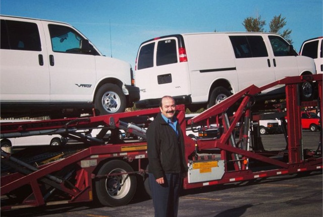 CEO Pablo Acedo poses with VIA eREV vans. Photo courtesy of VIA.