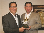 """<p><em><strong><span class=""""s1"""">Robert Brown, Great Lakes regional sales manager for Automotive Fleet (right), presents the 2014 Fleet Truck of the Year Award to Fritz Ahadi, general manager of commercial and government operations for Ford Motor Co.</span>Photo courtesy of Robert Brown.</strong></em></p>"""