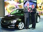 """<p><em><strong><span class=""""s1"""">Bob Brown Jr., Great Lakes sales manager for Automotive Fleet (right), presented the 2014 Fleet Car of the Year Award to Ed Peper, U.S. vice president for fleet and commercial sales for GM. </span>Photo courtesy of Robert Brown.</strong></em></p>"""