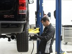 <p>A GMC Cerified Technician performs a tire rotation — one component of the maintenance coverage included in Pro Grade Protection — on a 2013 Sierra 1500.</p>