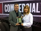 <p><em>Senior Editor Chris Wolski Presents the Medium-Duty Truck of the Year award to Becky Blanchard, director of the Ram Truck brand. Photo by Chris Brown.<br /></em></p>