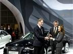 Laura Burstein (right) hands Peter Schwarzenbauer, Audi board member