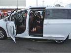 Fleet customers check out the inside of the Chrysler Pacifica minivan.
