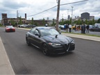 A fleet customer enjoys a drive around downtown Detroit in the Alfa