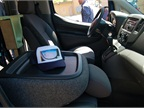 The passenger seat folds flat to act as a mobile desk. The center