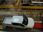 A completely finished aluminum F-150 queues up for its final inspection and test drive.