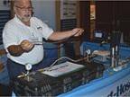 Robert Cardona demonstrates the Smart-Hose Break-Away Safety System at