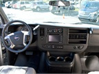 The truck-like interior for this Savana includes navigation and a