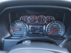 The instrument cluster display offers data on trip, fuel economy,