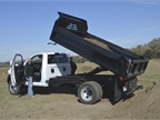 A 2016 Ram 5500 Chassis Regular Cab Tradesman 4X4 with dump bed upfit