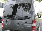 The rear doors of all the passenger vans are held open by heavy-duty,