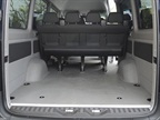 Looking into the rear of the extended-length passenger van shows ample