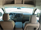 The center console provides room for storage of a laptop or work
