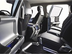 The seat design provides extra legroom and storage for rear-seat