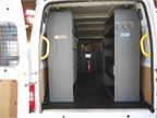 Inside the cargo area of the Transit.