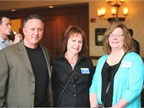 Mike Whelan of Wheels Inc. (left), GM's Judy Brophy (center) and