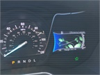 The instrument panel cluster display shows growing leaves to gauge eco