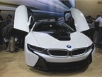 The 2014 BMW i8 plug-in hybrid supercar with gull-wing doors will