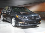 The 2014 Acura RLX offers a three-motor hybrid powertrain that